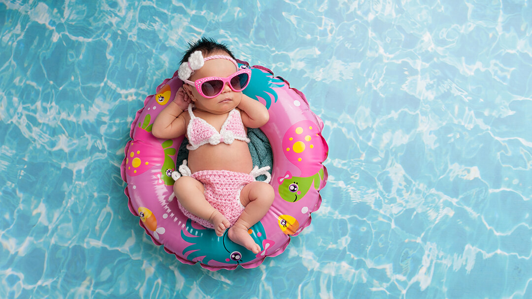 Baby floating in pool